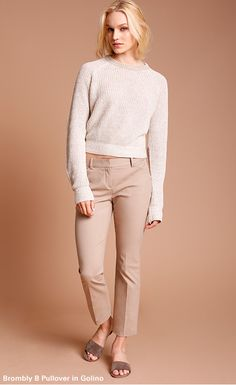 A loosely knit, slightly cropped crewneck sweater in an easy-to-wear neutral color. Pair with high-waisted pants, or layer over a crisp cotton shirt. Made from a rich linen yarn imported from Italy with a luxurious sheen and drape.