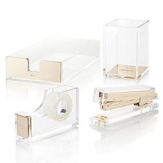 Kate Spade New York Strike Gold Acrylic Desk collection.  Stapler, tape, letter tray, and pencil cup.  http://www.urbangirl.com/Products/kate-spade-new-york-Acrylic-Desk-Set__KSPACRYLICDESKSET.aspx