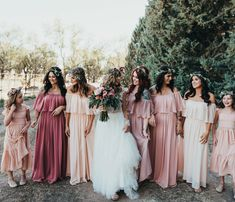 b14aa963437 Bridesmaids in off the shoulder boho dresses in various shades of pink look  at each other