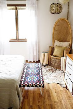 Using plywood, foam batting, and legs, a small rug can be turned into a DIY bedside bench.  Source: A Beautiful Mess