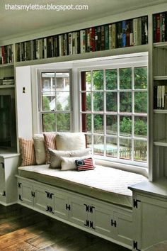 What an inviting room!  Love the idea of having a library with a bay-window-reading nook.