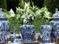 blue and white vases arranged on dining room table
