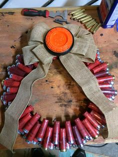 Shotgun shell crafts 12g shotgun shell Xmas wreath, complete with lacquered clay pigeon and burlap bow. Like a boss. Made it in about 2 hours start to finish.