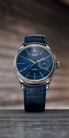 The Rolex Cellini Date in 18 ct white gold with a blue guilloche dial and a blue alligator leather strap.