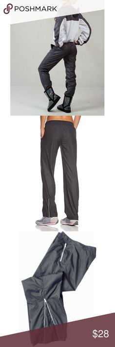 """Fila Windfly Windbreaker Trek Wind Sweatpants M Comfort you can count on. These women's FILA SPORT workout pants give you the ultimate combo of support and style.  * Perfect for medium-impact exercise * Moisture-wicking technology * Inside mesh lining  * 30"""" inseam * Midrise sits above the hip * Zip velcro fastening * Zip release hems Fila Pants Track Pants & Joggers"""