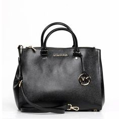 @Overstock - MICHAEL Michael Kors Jet Set Travel Large Dressy Black Tote - This classic large black sutton leather Michael Kors Satchel is the perfect addition to any woman's purse collection.  http://www.overstock.com/Clothing-Shoes/MICHAEL-Michael-Kors-Jet-Set-Travel-Large-Dressy-Black-Tote/9207163/product.html?CID=214117 $359.99