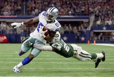 Dez Bryant Photos Photos - Dez Bryant #88 of the Dallas Cowboys carries the ball and scores a touchdown against  Darrelle Revis #24 of the New York Jets in the second quarter at AT&T Stadium on December 19, 2015 in Arlington, Texas. - New York Jets v Dallas Cowboys