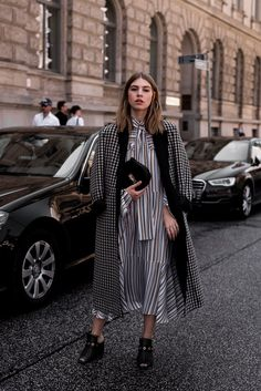 More on www.offwhiteswan.com Striped Pattern Mix, Midi Dress by Dorothee Schumacher, Checked Wool Coat by Dorothee Schumacher, Gingham, Vichy Karo, Mules by Dorothee Schumacher, Chloé Drew Bag black, Berlin Fashion Week, Streetstyle Fashion Week, Berlin Streetstyle, mbfw, mbfwb, mbfwberlin, Fashion Editorial, summeroufit, summerlook, Fashionweek, Casual Streetstyle, layering, summer, ootd, look of the day, Fashionblog München, Modeblog München #swantjesoemmer #offwhiteswan