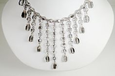 """Gray Faceted Round Crystal, Antique Silver Toggle Clasp 20"""" long Necklace    Delicate gray faceted round crystal with dangling oval faceted gray crystals with silver toggle clasp necklace.    20"""" long from clasp to bar. 3"""" 1/2 long dangling beads.    Includes: Handcrafted gift box."""