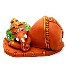 Gift this terracotta handpainted sleeping Ganesha idol to your loved ones to accentuate the beauty of their home. Costs Rs 510/- http://www.tajonline.com/gifts-to-india/gifts-HEL155.html?aff=pinterest2013/