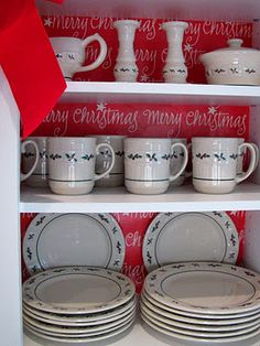 Add Christmas wrapping paper to the interior of your china cabinet! & Longaberger colored pottery. | Longaberger | Pinterest | Pottery ...