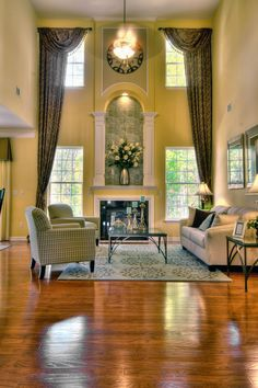 Dramatic two-story great room from Eastwood Homes! Building new homes in North C… Dramatic two-story great room from Eastwood Homes! Building new homes in North Carolina, South Carolina, and Virginia High Ceiling Living Room, Living Room Windows, Living Room With Fireplace, Formal Living Rooms, Home Living Room, Living Room Decor, Two Story Fireplace, Tall Window Treatments, Foyer Decorating