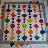 like the simplicity of piecing ... 4 patches and alt squares of solids. Border is cool too.