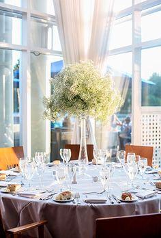 Modern, white baby's breath wedding reception table centerpiece (Meredith Hanafi Photography)