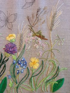 Breath of Spring - Grasshopper - stitched using long and short, satin, straight, stem stitched and billions using variegated stranded cotton.