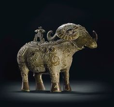 A Highly Important and Extremely Rare Bronze Ritual Ram-Form Wine Vessel, Zun. Late Shang Dynasty, 12th-11th century BC. 6 in (15.4 cm) high.