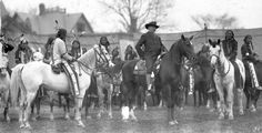 Photo taken 1901 in England. William F. Cody (aka Buffalo Bill) is in center on horseback. Iron Tail (Oglala) is in right foreground on horseback.