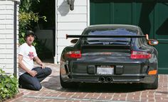 After another workout at the Easton Gym, Patrick Dempsey hops into his classic Jaguar XK 120 and heads home. Once there, he makes a shoeless dash across the street, retrieves his orange and black Porsche, and pulls it into his driveway. Patrick scrapes the Porsche LOUDLY and decides to kneel down to check for damage.