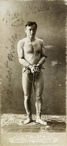 Publicity photograph of Harry Houdini, Houdini's most famous escape acts usually involved him being chained and locked in a jail cell. Image courtesy of Tony Oursler's personal archive.