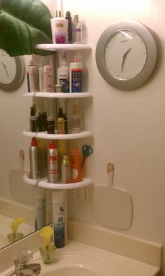 Totally solved my cluttered bathroom countertop problem with a $14 shower rack from Target!