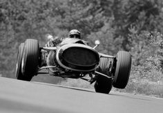 Jo Siffert of Switzerland gets the front wheels off the ground as he drives the Rob Walker Racing Team / Jack Durlacher Cooper Maserati during practice for the German Grand Prix on 5 August 1967 at the Nurburgring near Nurburg, Germany. F1 Racing, Racing Team, Drag Racing, Motogp, Maserati, Jochen Rindt, Car Food, Italian Grand Prix, Automobile