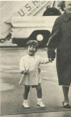 Oh what a beautiful adventure - thought John F. Kennedy Jr. He rode with his dad via helicopter to Anderson Air Force Base, trotted along behind the president to the big plane waiting there; scampered up the ramp to join the travelers - then got hauled down and sent home with his nurse. Poor little fella - he thought he was going on the trip, but it was only goodbye again - and tears!