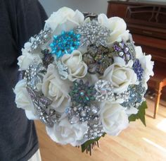 Great tutorials for brooch bouquets that cost way less than store bought.  http://www.youtube.com/watch?v=ONASA0L_Ma4  Part 2 s here  http://www.youtube.com/watch?v=c2iTqNxI1Og  Watch and learn!!!!!!!!!!!!  Google brooch bouquet images to get some ideas on what you want your bouquet to look like.