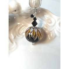 Art glass necklace, pendant, earth tone lampwork bead and crystals ❤ liked on Polyvore featuring jewelry, necklaces, chain necklace, swarovski crystal pendant necklace, beaded pendant, pendant necklaces and glass bead jewelry