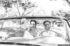 Black and white wedding photography in vintage car