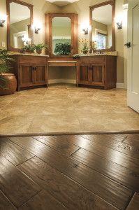"Master Bedroom- 5"" Handscraped Engineered Hardwood; Bath-18""x18"" Ceramic Tile Laid Diagonally"