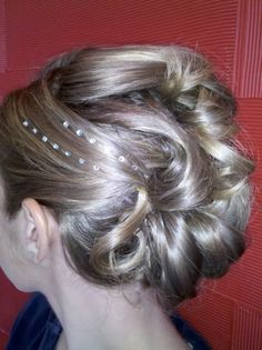 Intricate updo w/ rhinestones done by one of our stylists, Andrea