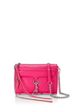 Mini M.A.C. Crossbody - A petite take on your favorite M.A.C. (Morning After Clutch) that's a little too cute for words!  With just enough space to stash your must-haves (lipgloss, cell phone, wallet, keys, and sunglasses) this compact style goes from daytime fun to evening with flair. Adjustable chain and studded leather strap can be singled, doubled, or removed.