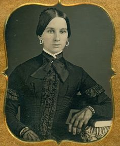 Daguerreotype of attractive lady with tinted jewelry