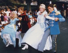 Princess Aurora and Prince Phillip , with Cinderella and her Prince, in July of 1987. This was part of Snow Whites 50th Anniversary Parade