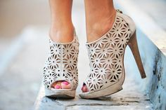 Ivory laser-cut booties.
