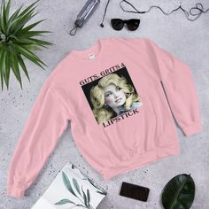 A sturdy and warm sweatshirt bound to keep you warm in the colder months. Dolly Parton Shirt, Shirt Store, Country Music, Cool Shirts, Rib Knit, Tennessee, Graphic Sweatshirt, Sweatshirts, Sweaters