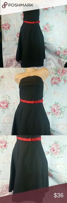 "Pinup black with red poka dot strapless dress Like new condition straoless dress from Ruby Rox size 6 L 34"" under bust 13"" [red ribbon]. Has tule and dress liner. Black with small red poka dots and red ribbon seen sash on the front. There is one very small white mark on the front of the dress. Perfect for a formal occasion or going out. Ruby Rox Dresses Strapless"