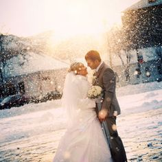 magical; a wedding pic while it's snowing. My dream!
