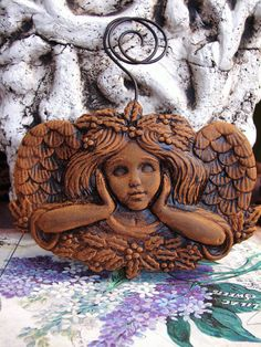 3D HOLLY ANGEL in Blackened Beeswax Wall Art by BlackRockFolkArt, $23.99