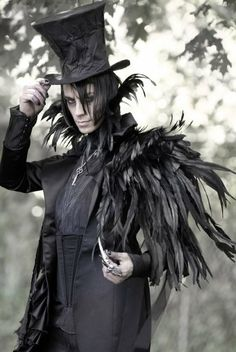 @crowhazard Made me think of you...Kind of a bad ass costume. Not anime, but just...cool ass goth costume...and bonus...CROW! <3