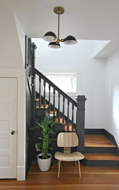 It may be small and narrow, but that doesn't mean your stairway can't get the same decorating treatment as the rest of your house. These staircase decorating ideas will give your entryway a step up. Find and save ideas about Painted stairs. Style At Home, Black Stairs, Black Banister, Black Painted Stairs, Painted Staircases, Painted Stair Risers, Bannister Ideas Painted, Entryway Stairs, Entryway Paint