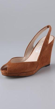 Love the vintage vibe of these peep toe wedges. #michaelkors