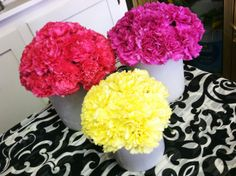 Color block carnation centerpieces in white wax vessels. Perfect for weddings, holidays, showers, and parties. @Cactus Flower www.cactusflower.com