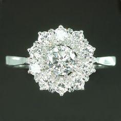 I am definitely considering something like this now. estate diamond cluster engagement ring