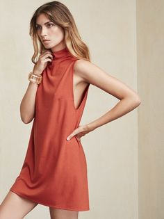 A mini dress that can also conceal a hickey for you. The Cali Dress. This is a ribbed stretch jersey shift dress with a turtleneck. There are darts at the side of the bust and the sides are low cut. Loose, easy fit. Show what you want. Made from 88% tencel / 12% spandex.