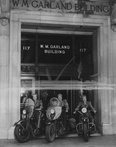 """The first female motorbike messengers for the aircraft industry are these silken-clad misses who speed inter-organization communications from Los Angeles headquarters to the three Timm plants. All professional riders, left to right—Chief Messenger Phyllis Domich, Dora """"Babe"""" Duncan, and Janet Spangenberg. They are posed outside the W. M. Garland Building."""