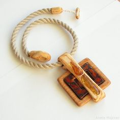 Hand-carved necklace made of wood and natural Baltic amber. majzner.eu/en/necklaces/1753-n… Dimensions of the pendant: 8,3cm x 7,2cm; Length of a necklace: 52cm; Weight: 32g;Materials: natur...