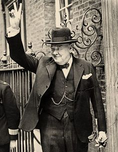 """Churchill making his famous """"V for victory"""" sign in 1943."""