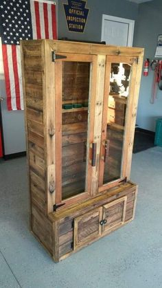 Gun Cabinet, built from pallets. The glass door and frame were from a farm house door that got the hack treatment. Nothing goes to waste