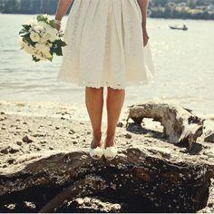 bride in knee length wedding dress